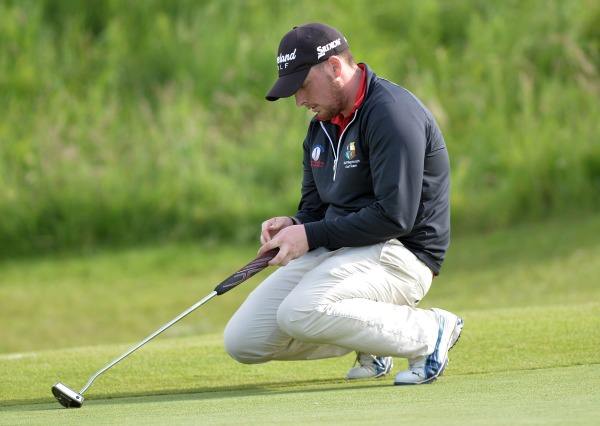 Down and Out...........Kieran Lynch (Skibbereen) sees his birdie putt on the 21st slip by during the second round of matchplay at the 2014 AIG sponsored Irish Amateur Close Golf Championship at Seapoint Golf Club today (09/06/2014). Picture by Pat Cashman  www.cashmanphotography.ie
