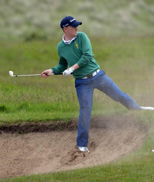 Geoff Lenehan (Portmarnock) playing his bunker shot at the 11th during the second round of matchplay at the 2014 AIG sponsored Irish Amateur Close Golf Championship at Seapoint Golf Club today (09/06/2014). Picture by Pat Cashman  www.cashmanphotography.ie
