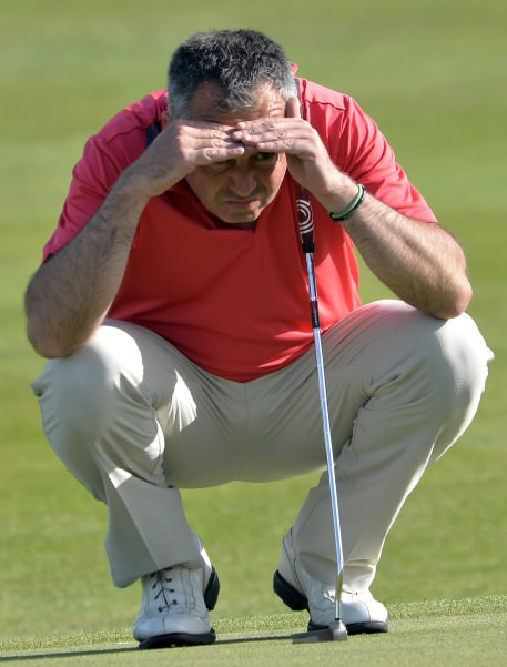 Pat Murray (Limerick) lining up his putt on the 18th during his quarter final match at the 2014 AIG sponsored Irish Amateur Close Golf Championship at Seapoint Golf Club today (10/06/2014). Picture by Pat Cashman