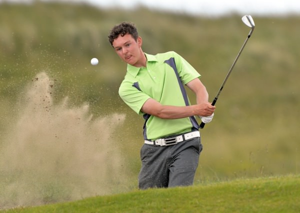 Winner John Ross Galbraith (Whitehead) blasting from the bunker at the 12th green. Picture by Pat Cashman www.cashmanphotography.ie