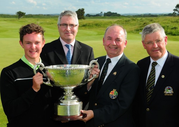 Michael Connaughton (President Elect GUI) presenting John Ross Galbraith (Whitehead) with the AIG sponsored 2014 Irish Amateur Close Golf Championship trophy.Also in the picture are John Boylan (Motor Manager, AIG Europe Limited) and Dan Reynolds (Captain, Seapoint Golf Club). Picture by Pat Cashman