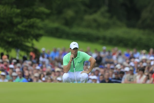 Rory McIlroy lines up his birdie putt on the ninth in the first round of the Irish Open. Picture: Fran Caffrey www.golffile.ie