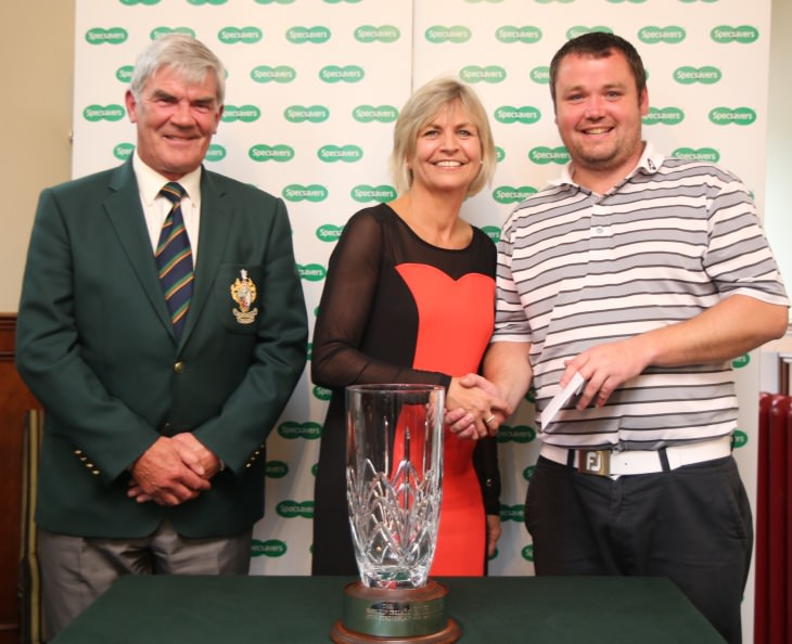 Galgorm Castle captain John Carruthers with event sponsor Valerie Penney (Director, Specsavers Ballymena) and winner Aaron Grant
