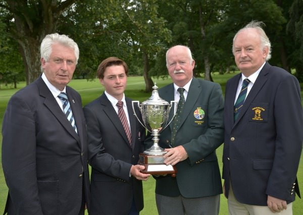 Liam Martin (President, Golfing Union of Ireland) presenting Bradley Moore (England) with the Irish Boys Amateur Open Championship Trophy at Thurles Golf Club to-day (27/06/2014). Also in the picture are John Moloughney (Chairman, Munster Branch, GUI) and Pat Fallon (Captain, Thurles Golf Club). Picture by Pat Cashman / www.cashmanphotography.ie