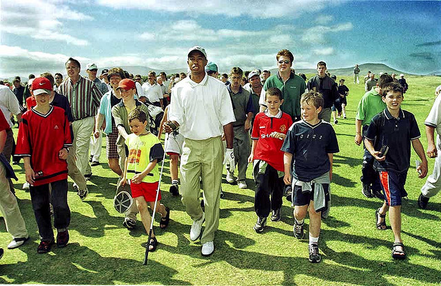 """Before the Whoosh became the Swoosh. Rare shot of Tiger Woods with real people close to him. Ireland in about 1998. Pre-Nike it seems."" © Mike King via Flickr"