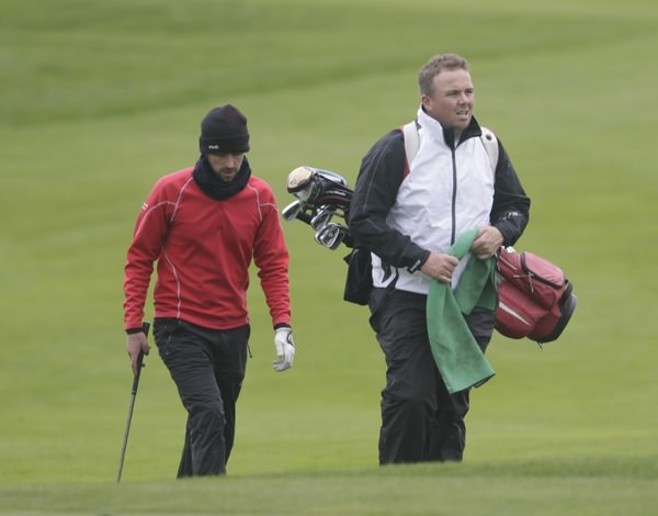 Dara Lernihan, pictured with his young caddie Shane Lowry during last year's Irish PGA at Roganstown, leads the Johnston Mooney & O'Brien PGA Challenge at Carton House. Picture Picture Fran Caffrey www.golffile.ie