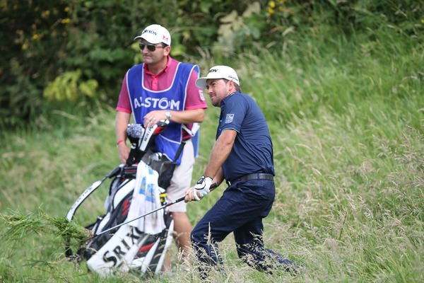 Graeme McDowell struggles to a double bogey seven at the 14th. Picture: David Lloyd / www.golffile.ie