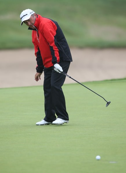 Damien McGrane urges his putt to break left. It didn't. Picture: David Lloyd / www.golffile.ie