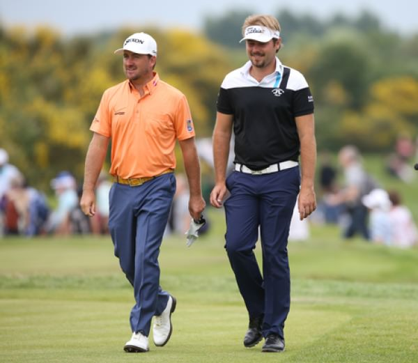 Graeme McDowell and Victor Dubuisson chat during round two of the Alstom Open de France. Picture: David Lloyd /  www.golffile.ie