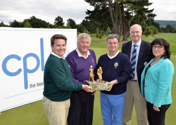 Brian Nevin (Captain, Castle Golf Club) presenting Paul Grimes (Killeen Castle) and his son Paul Grimes (Portmarnock) with the 2014 CPL Resources sponsored All Ireland Father & Son trophy after their victory at Castle Golf Club (13/07/2014). Also in the picture are Karl Devenney (Chairman, Father & Son Committee) and Ann Heraty (CEO, CPL Resources). Picture by Pat Cashman www.cashmanphotography.ie