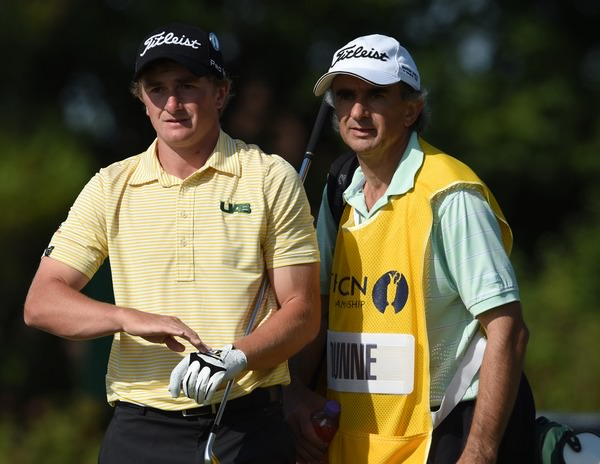 Paul Dunne and his father Collie weigh up their options. Picture Fran Caffrey, www.golffile.ie