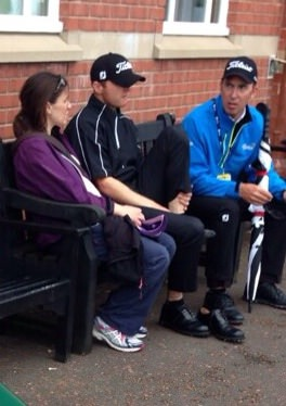 Michael Hoey speaks with his wife Bev and one of his coaches, Justin Parsons shortly after his withdrawal with a foot injury in the Open Championship at Royal Liverpool.