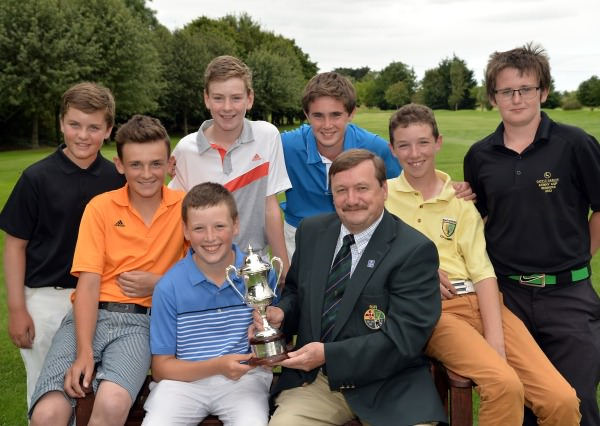 Kevin McIntyre (Chairman, Leinster Golf, Golfing Union of Ireland) presenting Scott Miller (Clandeboye) with the Leinster Boys' Under 13 Open Championship trophy after his victory at Corrstown Golf Club (21/07/2014). Also in the picture are fellow prizewinners Shane Irwin (Killeen), Joshua McCabe (Roganstown), Robert Galligan (Elm Park), Peter Taylor (Tandragee), Sean Doyle (Black Bush) and Patrick Callaghan (Castle Dargan). Picture by Pat Cashman