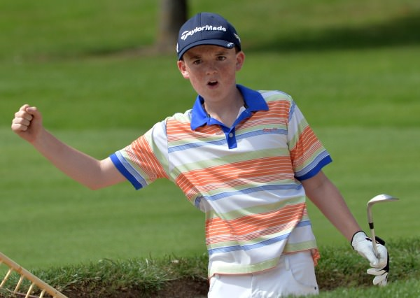 Max Kennedy (The Royal Dublin) show his delight at nearly holing from the bunker at the 17th green during the Leinster Boys' Under 13 Open Championship at Corrstown Golf Club (21/07/2014). Picture by Pat Cashman