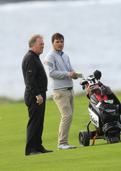 Shandon Park's Stuart Bleakley with his father Geoff on the bag at Lahinch this morning. Picture Thos Caffrey www.golffile.ie