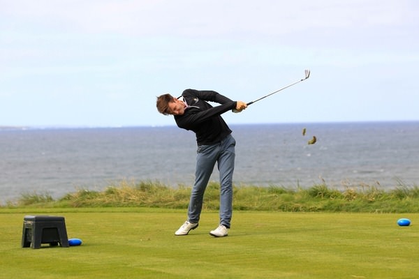 Richard Knightly hits his tee shot at the eighth in the semi-finals of the South of Ireland Amateur Open at Lahinch. Picture Thos Caffrey www.golffile.ie