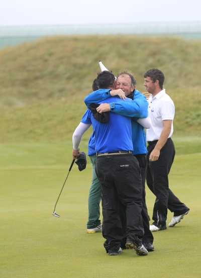 An emotional embrace between the champion and his father and caddie, PGA professional Geoff Bleakley. Picture: Thos Caffrey / www.golffile.ie