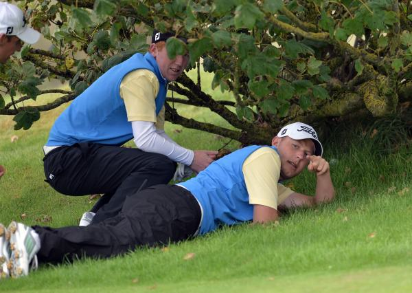Paul McBride and Gavin Moynihan (The Island) discussing their playl at the 16th during the AIG Barton Shield final at Laytown & Bettystown Golf Club today (02/08/2014). Picture by  Pat Cashman
