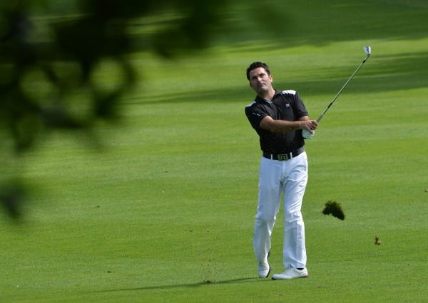 Gary O'Flaherty (Cork) playing his second shot at the 18th in the final round of the 2014 Leinster Mid Amateur Open Championship at the Grange Golf Club today (09/08/2014).  Picture by   Pat Cashman