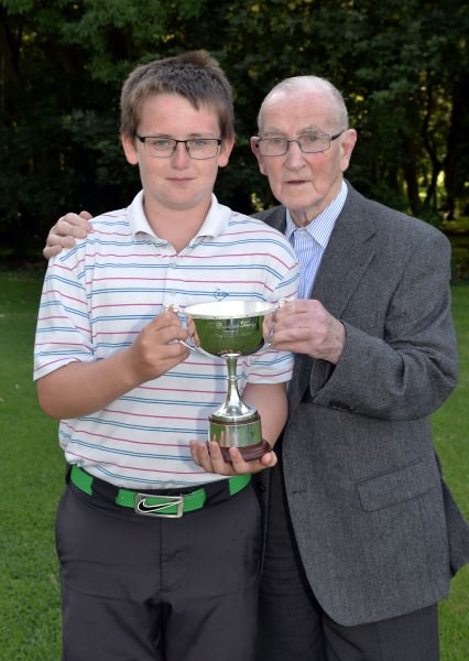Winner Patrick Callaghan (Castle Dargan) pictured with Paddy Craddock after his victory in the 2014 Irish Boys Under 13 Amateur Open Championship (Craddock Trophy) at Malahide Golf Club (11/08/2014). Picture by Pat Cashman