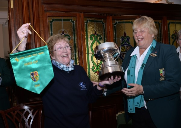 Mary McKenna (President, Irish Ladies Golf Union) presenting Laytown & Bettystown Aileen Regan (Team Captain) with the 2014 AIG All Ireland Ladies Senior Cup trophy and pennant after their victory at Mount Wolseley Country Club. (16/08/2014). Picture by  Pat Cashman
