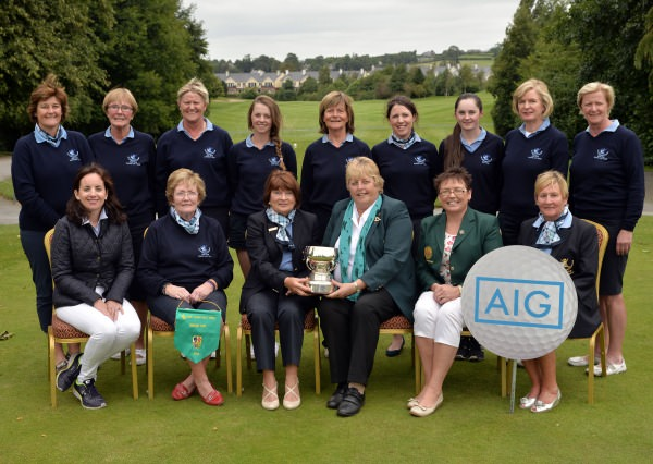 Mary McKenna (President, Irish Ladies Golf Union) presenting Millie Wade (Lady Captain, Laytown & Bettystown Golf Club) with the 2014 AIG All Ireland Ladies Senior Cup trophy after their victory at Mount Wolseley Country Club today (16/08/2014). In front (from left) Claire Scanlon (Business Development Manager, AIG Ireland), Aileen Regan (Team Captain), Eilish Hanley (Lady Captain, Mount Wolseley Golf Club) and Hazel Lee (Lady President, Laytown & Bettystown Golf Club). At back (from left) Alison Taylor, Rita O'Connor, Phil O'Gorman, Rachel Taylor, Patricia McAllister, Barbara Cooney, Ellie Metcalfe, Noeline Quirke and Carol Wickham. Picture by  Pat Cashman