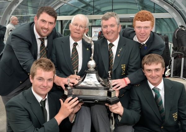 Team Captain Padraig Hogan (Elm Park) with selector Tony Goode (Lucan) and Leinster players Richard Bridges (Stackstown), Jack Hume (Naas) and Eisenhower Trophy picks Gavin Moynihan (The Island) and Paul Dunne (Greystones) pictured with the Raymond Trophy after their victory in the Home Internationals on their arrival at Dublin Airport today (16/08/ 2014). Picture by Pat Cashman