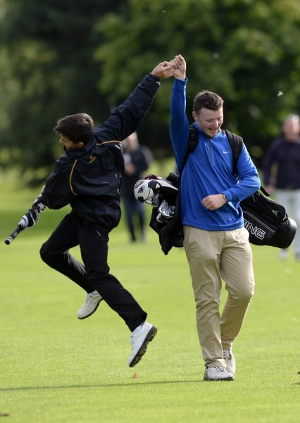 Bangor Golf Club Junior Foursome team member Corrie McAllister receives high fives from 15 year old supporter Daniel Young after their victory at the 2014 Irish Junior Foursomes Finals at Castlewarden Golf Club (18/08/2014). Picture by Pat Cashman