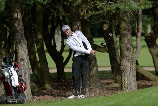 Mikey Burke (Galway) playing from the trees at the 16th hole in the Irish Junior Foursomes Final at Castlewarden Golf Club. Picture by Pat Cashman
