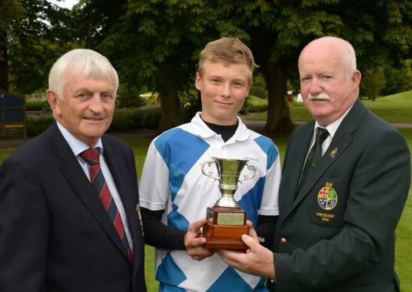 Liam Martin (President, Golfing Union of Ireland)  presenting Perre Papunen (Finland) with the Irish Under 15 Boys Amateur Open Championship trophy after his victory at Castlewarden Golf Club (20/08/2014). Also in the picture is Bill Moran (Captain, Castlewarden Golf Club). Picture by Pat Cashman