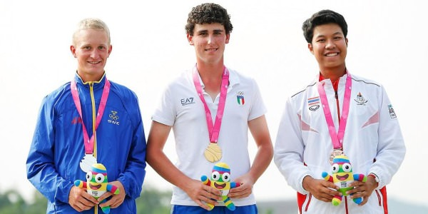 Sweden's Marcus Kinhult., Italy's Renato Paratore and Thailand's Danthai Boonma show off their Olympic medals