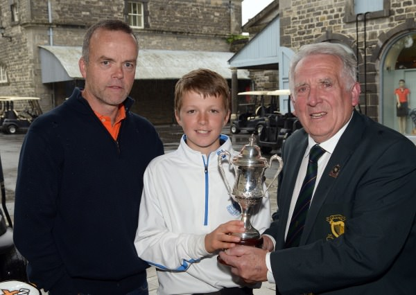 John Ferriter (Hon Secretary, Leinster Golf) presenting Ronan Cowhey (Elm Park) with the Titleist sponsored 2014 Leinster Boys Under 13 Series trophy after his victory at Carton House Golf Club today (21/08/2014). Also in the picture is David Cowhey (Dad). Picture by Pat Cashman