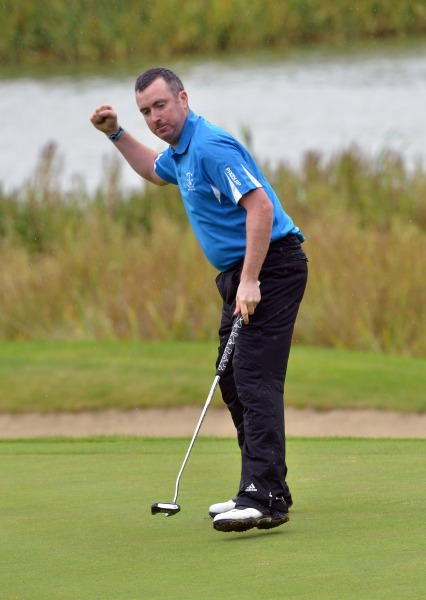 Mark Mullen (Rosslare) holes the winning putt on the 18th green in the 2014 AIG Leinster Senior Cup final at Mount Juliet Golf Club today (24/08/2014).  Picture by   Pat Cashman