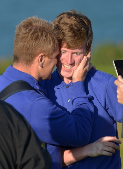 Carton House Brendan Boucher (Team Captain) congratulating Dean Cafferty after his victory on the 20th green to clinch the 2014 Fred Daly All Ireland final at Ardglass Golf Club today (26/08/2014). Picture by Pat Cashman