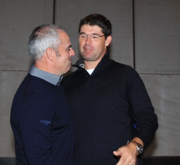 Pádraig Harrington congratulates Paul McGinley on his appointment as European captain on 15 January 2012 in Abu Dhabi. Picture: Fran Caffrey/ www.golffile.ie