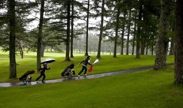 Princess Superal, (left), and Pauline Del Rosario of the Philippines, walk to the third tee on the Karuizawa 72 Golf East (Iriyama Course) during practice round at the 2014 Espirito Santo Trophy at Karuizawa 72 Golf East in Karuizawa, Japan on Monday, Sept. 1, 2014.  (Copyright USGA/Steven Gibbons)