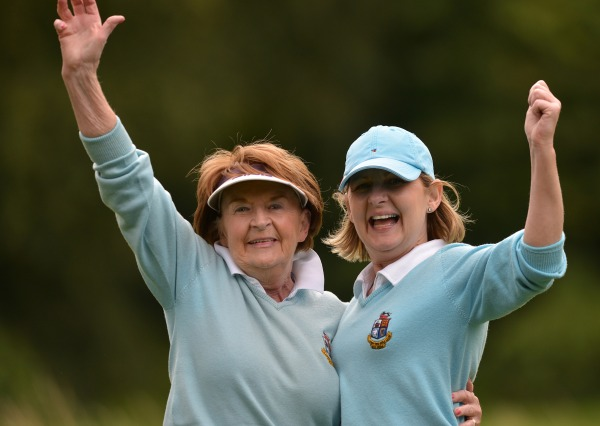 Co Longford's Tracy Farrell (right) celebrates with her caddy mother Pat Farrell after winning the crucial match on the 17th green for Co Longford Golf Club to clinch the 2014 Private Home Care Connacht District Ladies Intermediate Cup at Athlone Golf Club (30/08/2014). Picture by Pat Cashman