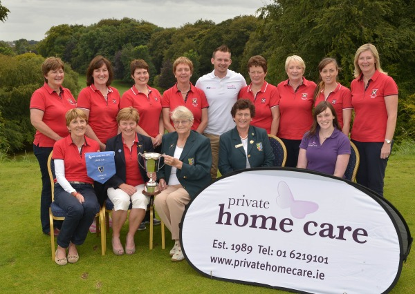 Mary Kennedy (Chairman, Connacht District, ILGU) presenting Dolores Towey (Lady Captain, Castlebar Golf Club) with the 2014 Private Home Care Connacht District Ladies Junior Cup after their victory at Athlone Golf Club today (30/08/2014). Also in the picture in front (from left) Breta Fitzmaurice (Team Captain), Kate O' Meara (Hon Secretary, Connacht District, ILGU) and Anna Llyod (Private Home Care). At back (from left) Evelyn Brady, Connie White, Lorna Irwin, Carmel Moran, Konrad Nicholson (Private Home Care), Shelia Baynes, Mary R McNulty, Leah Kerr and Beverly Cooper Flynn (Assistant Team Captain). Picture by Pat Cashman