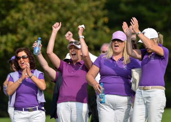 Waterford Castle Golf Club supporters celebrate their win on the 16th green during the semi final of the I Need Spain Irish Mixed Foursomes at Warrenpoint Golf Club (04/09/2014). Picture by Pat Cashman