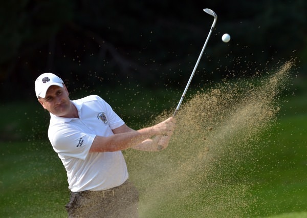 Danny Sinnott (Waterford Castle) plays his bunker shot to the 16th green during the semi final of the I Need Spain Irish Mixed Foursomes at Warrenpoint Golf Club (04/09/2014). Picture by Pat Cashman