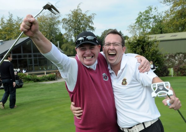 John Butterly and Ronan O'Neill (Corrstown) celebrate their victory on the 18th green in the final of the 2014 FBD Barton Cup at Athy Golf Club (06/09/2014). Picture by Pat Cashman