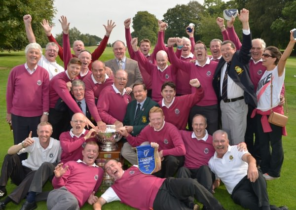 Kevin McIntyre (Chairman, Leinster Golf, GUI) presenting Eddie McDonnell (Captain, Corrstown Golf Club) and Tom Monaghan (Team Manager) with the 2014 FBD Barton Cup after their victory at Athy Golf Club (06/09/2014) with jubilant team members and supporters. Picture by Pat Cashman