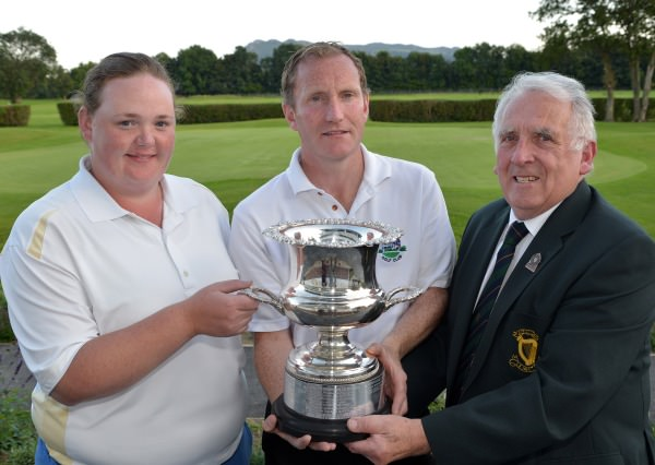 ohn Ferriter (Hon Secretary, Leinster Golf, GUI) presenting Louise Coffey (Malone) and Peter McNeill (Woodbrook) with the 2014 Leinster East of Ireland Mixed Foursomes trophy after their victory at Woodbrook Golf Club (07/09/2014). Picture by  Pat Cashman