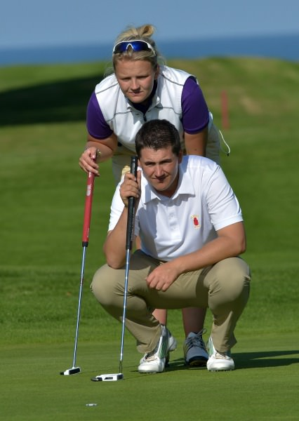 Colm Campbell and Tara Gribben (Warrenpoint) lining up their putt at the 11th green in the final round of the 2014 Leinster East of Ireland Mixed Foursomes at Woodbrook 07/09/2014). Picture by  Pat Cashman