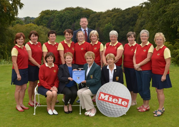 Vonnie Noonan (ILGU Board Member) presenting Ann Treacy (Lady Captain, Tuam Golf Club) with the 2014 Miele All Ireland Ladies Interclub Fourball Regional Final pennant after their victory at Athlone Golf Club. Also in the picture in front are Catherine Canavan (Team Manager) and Lily O'Sullivan (Lady Captain, Athlone Golf Club). At back (from left) Jacqui McGrath, Jackie Cullen, Annete O'Neill, Martina Casserly, Lorna Mullally, Pat McGrath (Miele Ireland), Siobhan Joyce, Mary Bollard, Mary McDonagh, Mary Roche and Ann Higgins. Picture by Pat Cashman