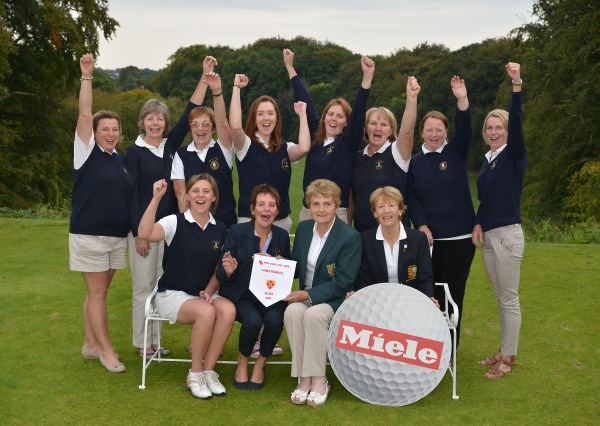 Vonnie Noonan (ILGU Board Member) presenting Marie Clifford (Lady Captain, City of Derry Golf Club) with the 2014 Miele All Ireland Ladies Interclub Fourball Regional Final pennant after their victory at Athlone Golf Club. Also in the picture in front are Ciara Quigg (Team Manager) and Lily O'Sullivan (Lady Captain, Athlone Golf Club). At back (from left) Vivienne Houston, Maire McReynolds, Betty McBride, Catherine McCanny, Naoimh Quigg, Geraldine Crossan, Jenny Flanagan and Gerda Laird. Picture by  Pat Cashman
