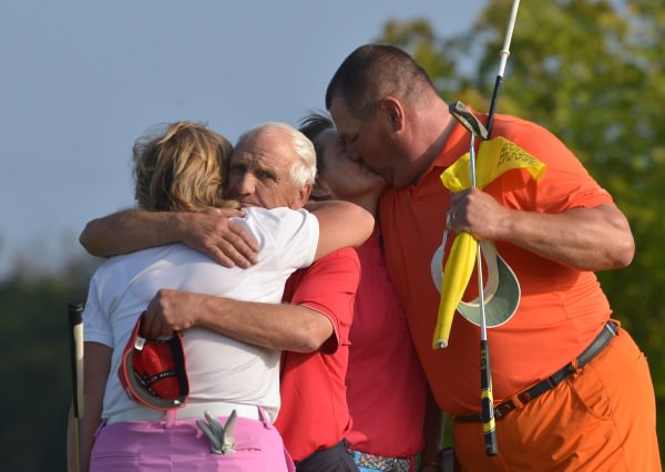 To the Victor a kiss, to the Vanquished a hug........Minna Kaarnalahti (Finland) receives a kiss from her husband caddy JP while caddy Frazer McMullen gives his wife Gertie a hug at the end of the six-hole play off in the 2014 Irish Senior Women's Open Strokeplay at Dundalk Golf Club (12/09/2014). Picture by Pat Cashman