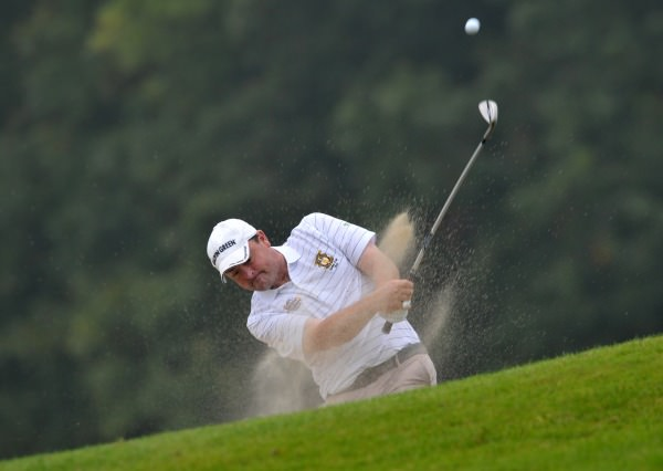 Paul Flynn (Tramore) plays from a bunker at the 19th hole in the  semi final of the AIG Senior Cup at Carton House today (19/09/2014). Picture by  Pat Cashman