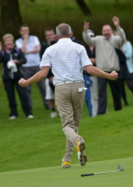 Tramore's Alan Thomas holes his birdie putt on the 19th green to clinch the AIG Senior Cup at Carton House today (20/09/2014). Picture by Pat Cashman