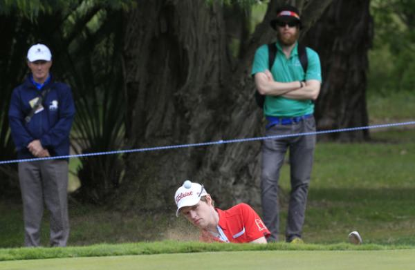 Kevin Phelan plays from a bunker on the 13th during round four of the ISPS HANDA Perth International at the Lake Karrinyup Country Club on Sunday 26th October 2014. Picture: Thos Caffrey / www.golffile.ie